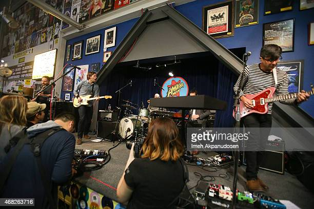 Musicians Nick Harmer Ben Gibbard Jason McGerr Zac Rae and Dave Depper of Death Cab for Cutie perform onstage for the release of their new album...