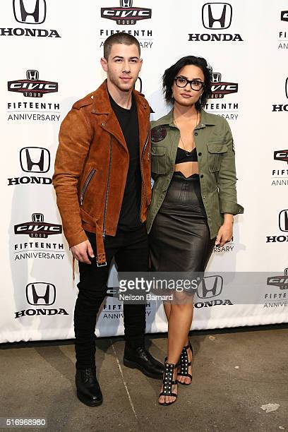 Musicians Nick Jonas and Demi Lovato attend the 2016 Honda Civic Tour Artists Announcement and Honda Civic North America Launch Event at the Garage...