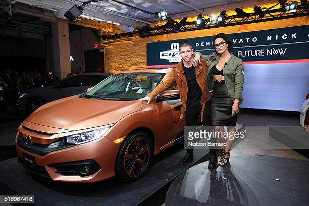 Musicians Nick Jonas and Demi Lovato pose with the 2017 Honda Civic Hatch at the Honda Civic Tour Artists Announcement and Honda Civic North America...