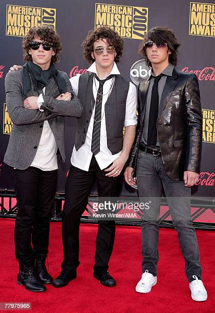 Musicians Nick Jonas Joe Jonas and Kevin Jonas from the Jonas Brothers arrive at the 2007 American Music Awards held at the Nokia Theatre LA LIVE on...