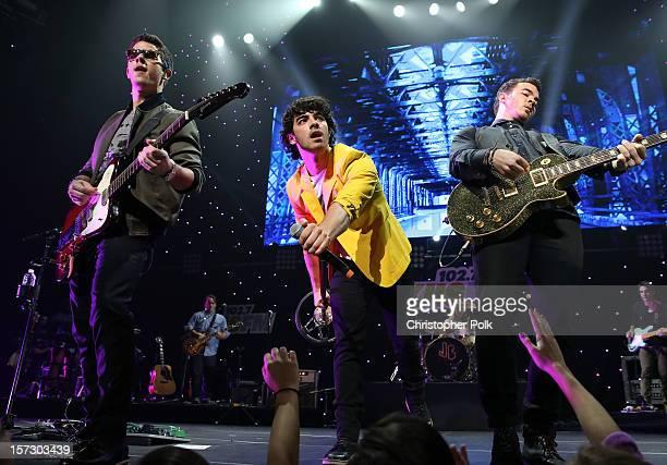 Musicians Nick Jonas Joe Jonas and Kevin Jonas of The Jonas Brothers perform onstage during KIIS FM's 2012 Jingle Ball at Nokia Theatre LA Live on...