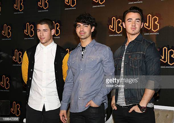 Musicians Nick Jonas Joe Jonas and Kevin Jonas of the Jonas Brothers attend a press conference at W Hotel Mexico City on January 23 2013 in Mexico...