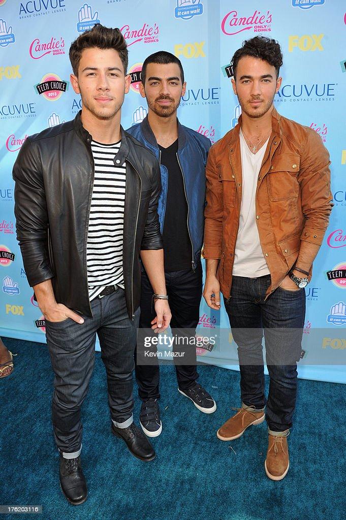 Musicians Nick Jonas, Joe Jonas, and Kevin Jonas of The Jonas Brothers attend the 2013 Teen Choice Awards at Gibson Amphitheatre on August 11, 2013 in Universal City, California.