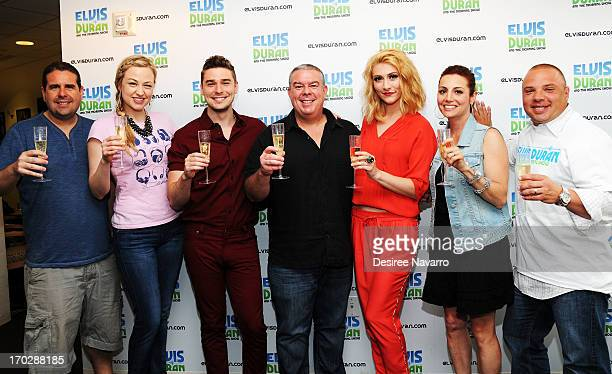 Musicians Nick Noonan and Amy Heidemann of the band Karmin pose with radio personality Elvis Duran and the Z100 Morning crew during their visit at...