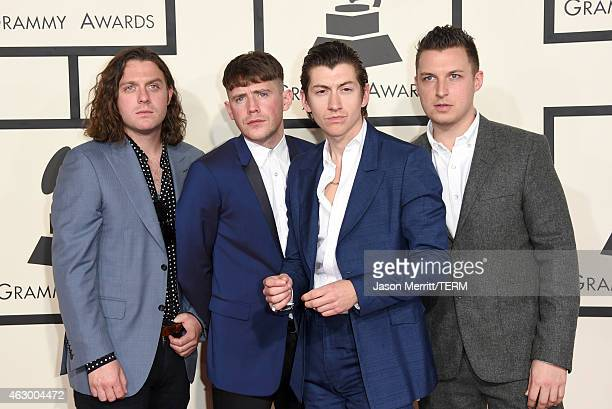 Musicians Nick O'Malley Jamie Cook Alex Turner and Matt Helders of Arctic Monkeys attend The 57th Annual GRAMMY Awards at the STAPLES Center on...