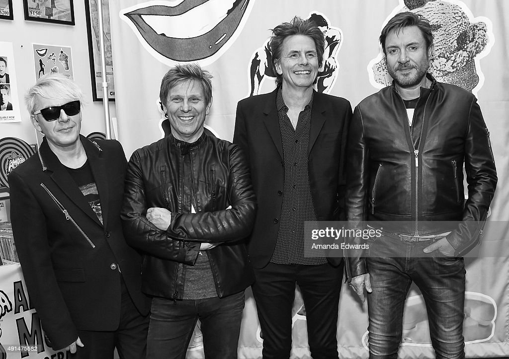 Musicians Nick Rhodes, Roger Taylor, John Taylor and Simon Le Bon of the band Duran Duran poses before signing copies of their new album 'Paper Gods' at Amoeba Music on October 5, 2015 in Hollywood, California.