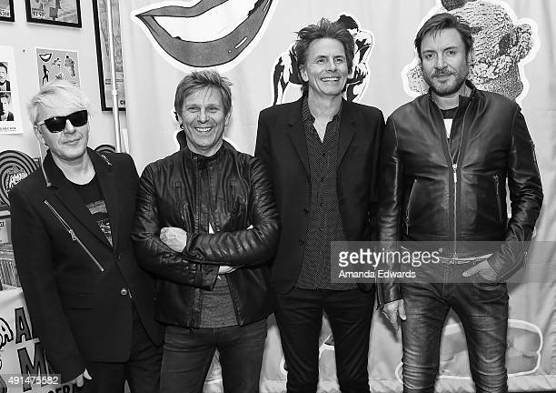 Musicians Nick Rhodes Roger Taylor John Taylor and Simon Le Bon of the band Duran Duran poses before signing copies of their new album 'Paper Gods'...