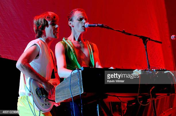 Musicians Nick Thorburn and Alden Penner of The Unicorns perform during The Reflector Tour at The Forum on August 2 2014 in Inglewood California