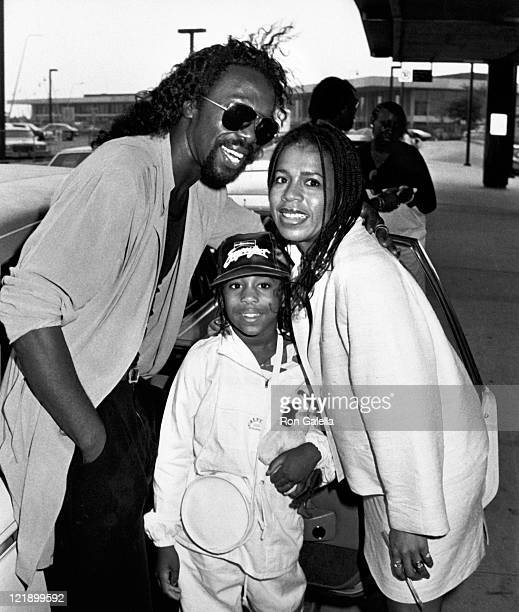 Musicians Nickolas Ashford and Valerie Simpson and daughter Nicole Ashford being photographed on August 4 1982 at JFK Airport in New York City New...