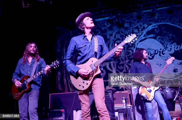 Musicians Nico Bereciartua Marc Ford and Sven Pipien of The Magpie Salute performs onstage at The Fonda Theatre on September 13 2017 in Los Angeles...