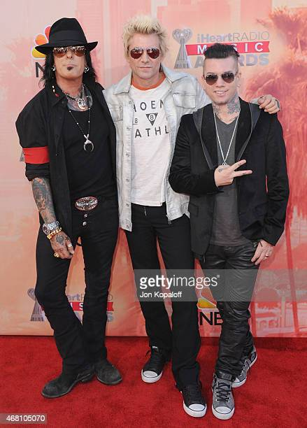 Musicians Nikki Sixx James Michael and DJ Ashba of SixxAM arrive at the 2015 iHeartRadio Music Awards at The Shrine Auditorium on March 29 2015 in...