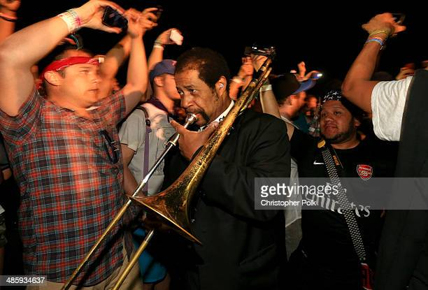 Musicians of Preservation Hall Jazz band perform with Arcade Fire in the crowd during day 3 of the 2014 Coachella Valley Music Arts Festival at the...