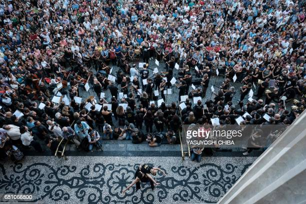 TOPSHOT Musicians of Rio de Janeiro's municipal theater perform during a protest demanding more than two months of umpaid salaries in front of the...