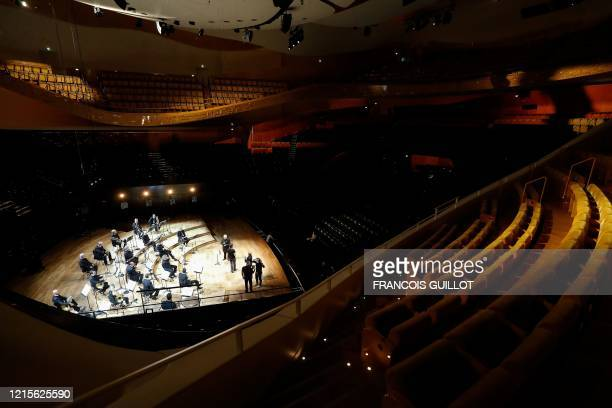 Musicians of the Orchestre de Paris perform in the empty Pierre Boulez hall in the Philharmonie de Paris in Paris on May 27 during a rehearsal ahead...