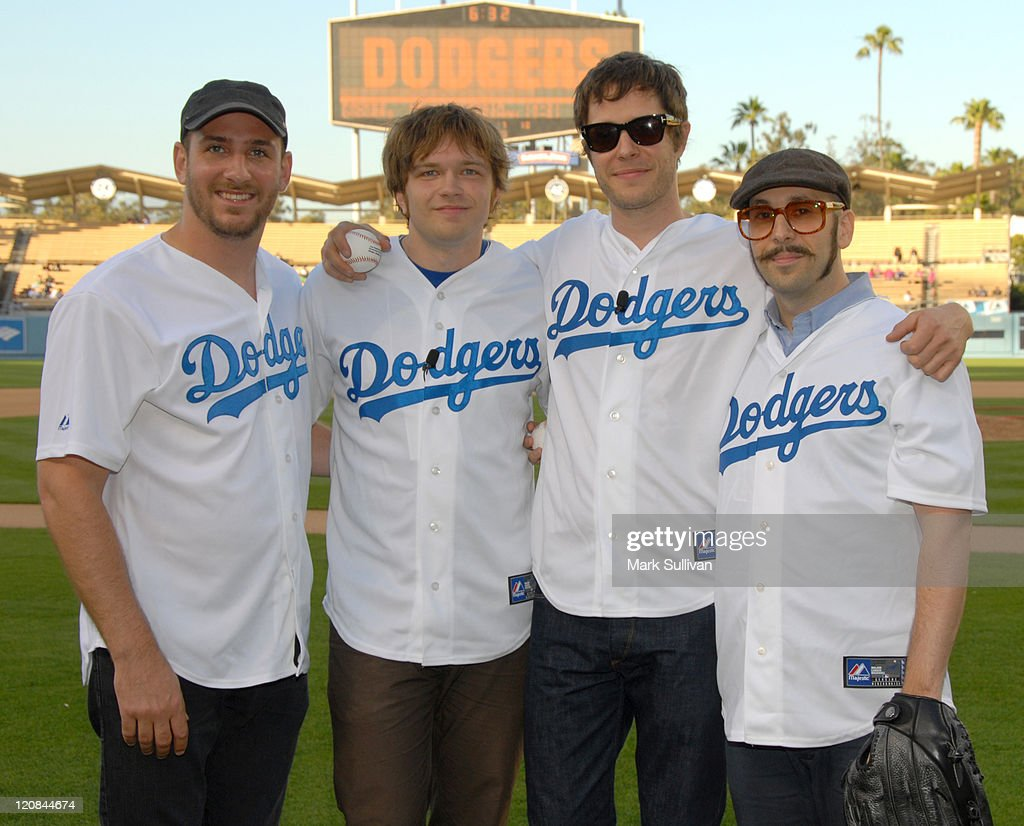Musicians OK Go Dan Konopka, Andy Ross, Damian Kulash and Tim Nordwind pose before throwing the ceremonial first pitch prior to the game between the Los Angeles Dodgers and the San Diego Padres at Dodger Stadium on May 20, 2010 in Los Angeles, California.