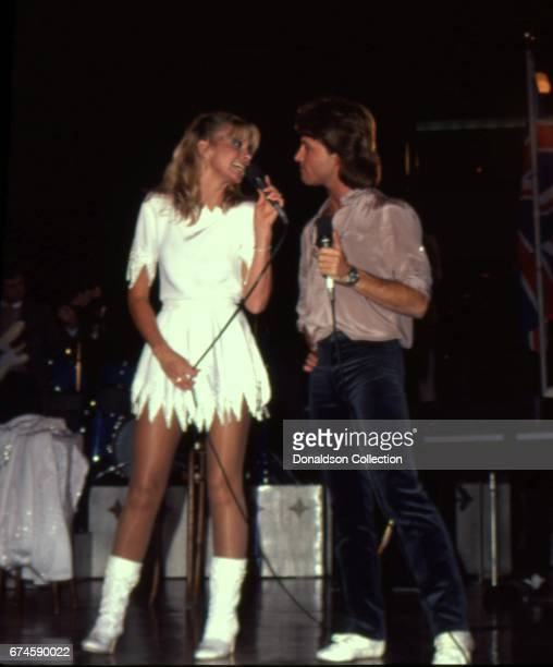 Musicians Olivia NewtonJohn and Andy Gibb perform on the Hollywood Nights TV special in March 1980 in Los Angeles California