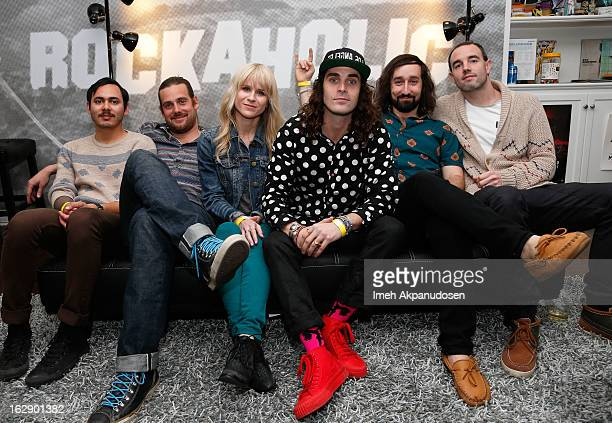 Musicians Omar Ahmed Tasso Smith Alice Katz Sam Martin Simon Katz and Nik Hughes of the band Youngblood Hawke pose backstage before performing at the...