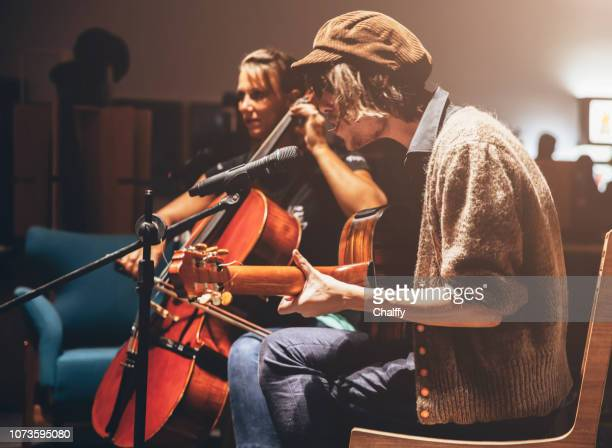 musicians on a stage - acoustic music stock pictures, royalty-free photos & images