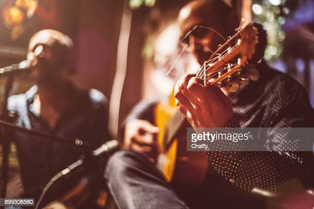 musicians on a stage - arts culture and entertainment stock pictures, royalty-free photos & images