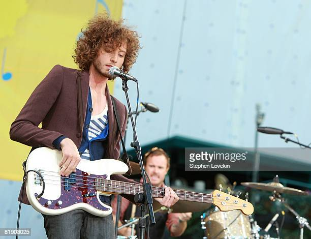 Musicians on ABrent Kutzle and Eddie Fisher of One Republic perform on ABC's Good Morning America in Bryant Park on July 11 2008 in New York City