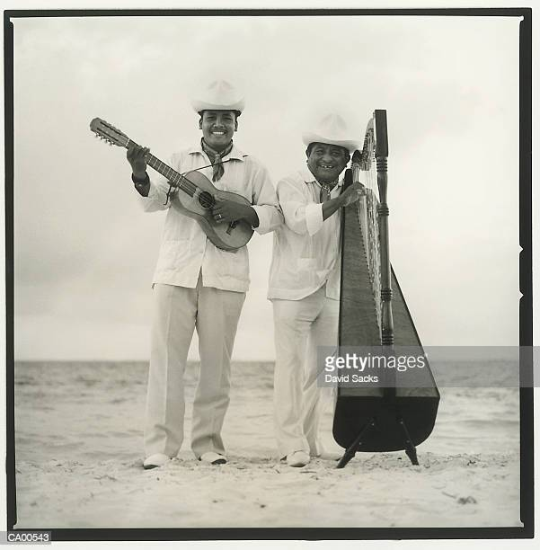 musicians on beach, portrait (b&w) - mexico black and white stock pictures, royalty-free photos & images