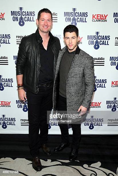 Musicians On Call President, Pete Griffin and Nick Jonas attend Musicians On Call Celebrates Its 15th Anniversary Honoring Kelly Clarkson And EVP Of...