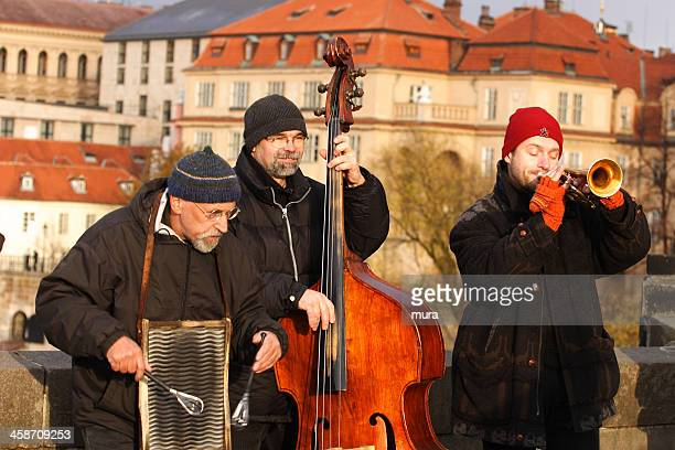 musicians on charles bridge, prague - traditional musician stock photos and pictures