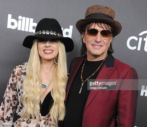 Musicians Orianthi and Richie Sambora arrive at the 2016 Billboard Power 100 Celebration at Bouchon on February 12 2016 in Beverly Hills California
