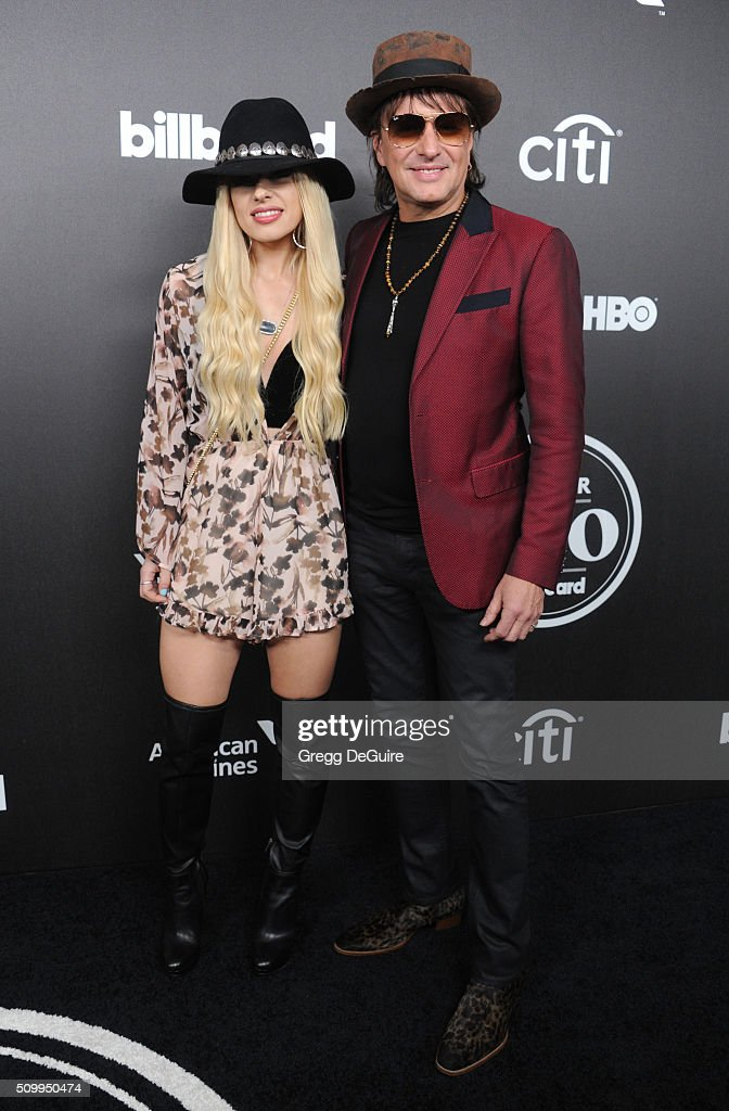 Musicians Orianthi and Richie Sambora arrive at the 2016 Billboard Power 100 Celebration at Bouchon on February 12, 2016 in Beverly Hills, California.