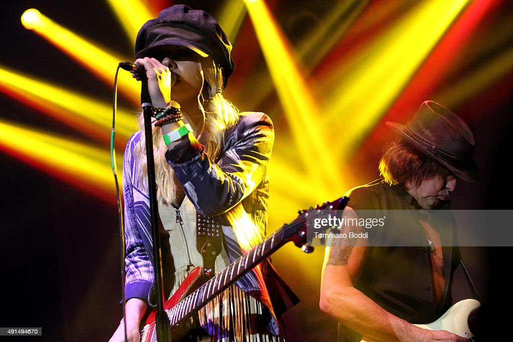 Musicians Orianthi and Richie Sambora perform on stage during the Medlock Krieger Celebrity Golf Invitational 2015 - All Star Concert held at Moorpark Country Club on October 5, 2015 in Moorpark, California.