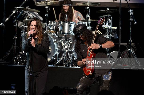 Musicians Ozzy Osbourne Tommy Clufetos and Slash perform onstage at the 10th annual MusiCares MAP Fund Benefit Concert to raise funds for MusiCares'...