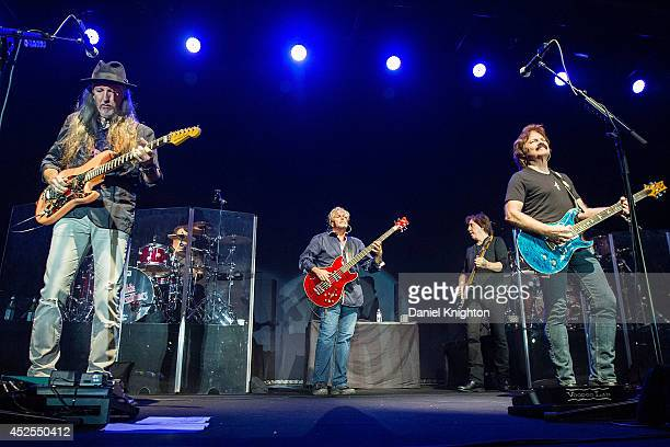 Musicians Pat Simmons John Cowan John McFee and Tom Johnston perform on stage with The Doobie Brothers on July 22 2014 in San Diego California