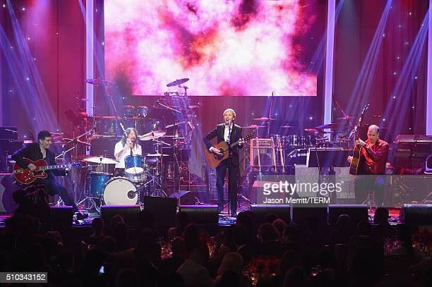 Musicians Pat Smear Dave Grohl Beck and Krist Novoselic perform onstage during the 2016 PreGRAMMY Gala and Salute to Industry Icons honoring Irving...