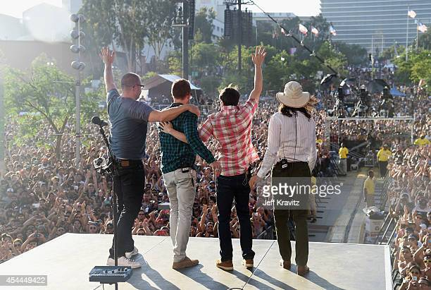 Musicians Patrick Wilson Scott Shriner Rivers Cuomo and Brian Bell of Weezer perform on the Marilyn Stage during day 2 of the 2014 Budweiser Made in...