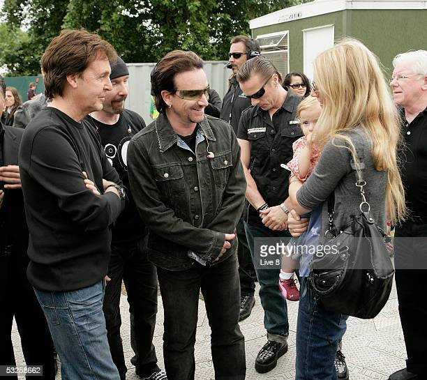 Musicians Paul McCartney and Bono and actress and wife of Coldplay's Chris Martin Gwyneth Paltrow with their daughter Apple seen backstage at Live 8...