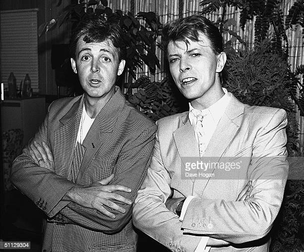 Musician's Paul McCartney and David Bowie backstage at Live Aid on 13th July 1985