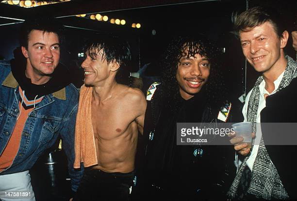 Musicians Paul Young Iggy Pop Rick James and David Bowie pose backstage after Pop's concert at the Ritz New York New York 1986