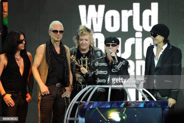 Musicians Pawel Maciwoda Rudolf Schenker James Kottak Klaus Meine and Matthias Jabs of the band Scorpions perform onstage during the World Music...