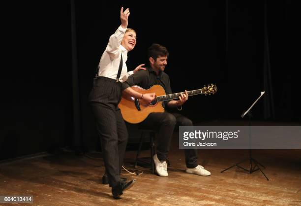 Musicians peform for Prince Charles Prince of Wales and Camilla Duchess of Cornwall during their visit to Sant'Ambrogio Market to celebrate the Slow...