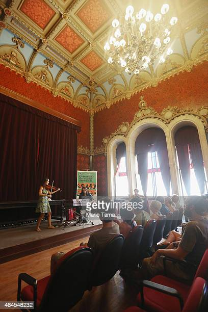 Musicians perform a noontime concert at the historic Royal Portuguese Reading Room January 13 2015 in Rio de Janeiro Brazil Rio marks its 450th...