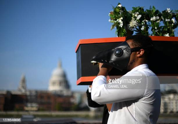TOPSHOT Musicians perform a staged funeral for the death of live music during a sociallydistanced photocall performance for One Night Records'...