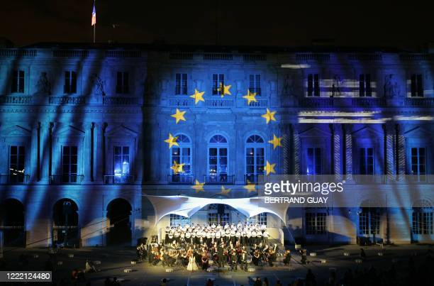 Musicians perform as images are projected onto the building at the Palais Royal after the Meetings for Europe and culture which gathers 800...