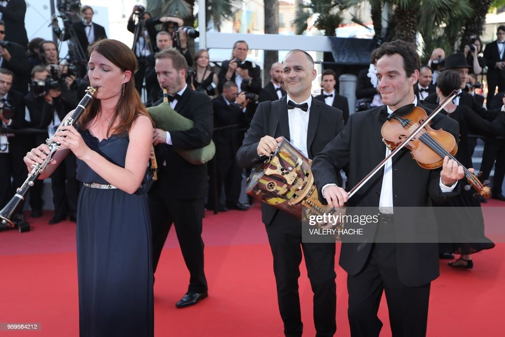 Musicians perform as they arrive on May 17, 2018 for the screening of the film 'Capharnaum' at the 71st edition of the Cannes Film Festival in Cannes, southern France.
