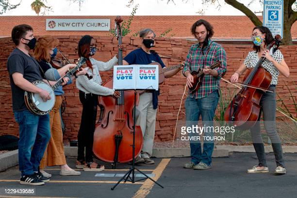 Musicians perform at the Burton Barr Library polling station as voter arrive to cast their ballots in Phoenix, Arizona, on November 3, 2020 -...