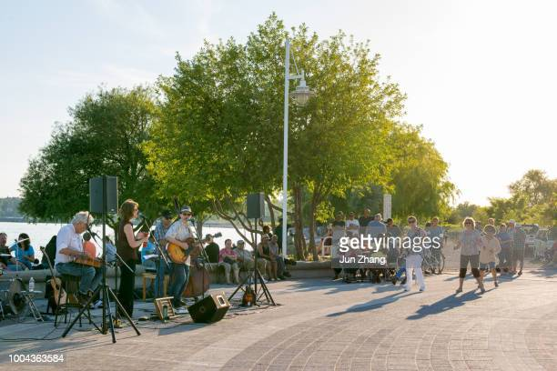 musicians perform at the millennium square, pickering, canada - great lakes stock pictures, royalty-free photos & images