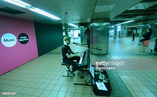 Musicians perform at the MTA's 27th annual 'Music Under New York' auditions at Grand Central Terminal on May 13 2014 in New York City A selection of...