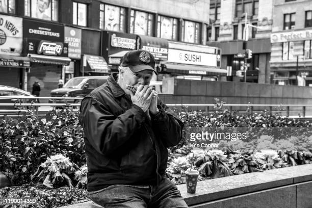 Musicians perform during Harmonica Parade as part of Make Music Winter at One Liberty Plaza on December 21 2019 in New York City