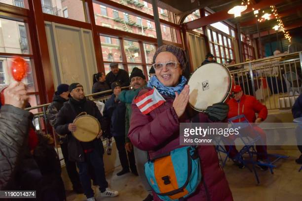Musicians perform during Jingle Train as part of Make Music Winter on December 21 2019 in New York City