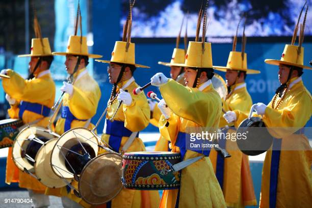 Musicians perform during the flag raising ceremonies during previews ahead of the PyeongChang 2018 Winter Olympic Games at the Pyeongchang Olympic...