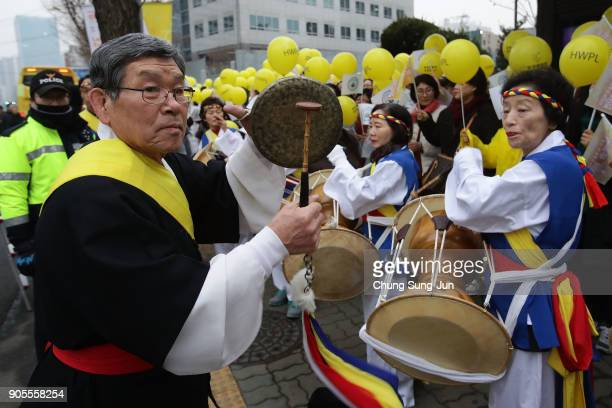 Musicians perform during the PyeongChang 2018 Winter Olympics torch relay on January 16 2018 in Seoul South Korea